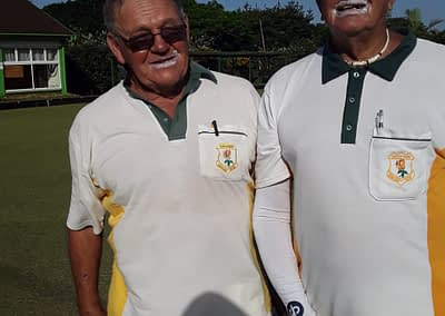 Dennis Graham and Johnny Meyer looking lawn-bowls-chic in the ultimate summer essential, sunscreen.